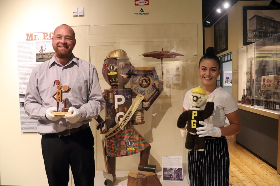Curator Alyssa Leier (right) and assistant curator Chad Hellenius with the lost metal Scottish Mr. PG. (via Hanna Petersen)