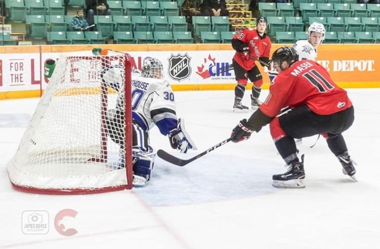 Josh Maser (#11) tips the puck inside the Victoria crease during a home game at the CN Centre (via Prince George Cougars/James Doyle Photography)