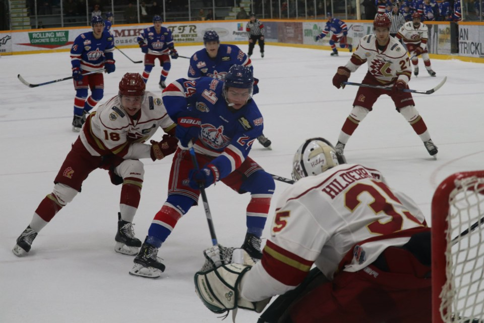 Nicholas Poisson (#24) dangles the puck for the Prince George Spruce Kings in front of the Chilliwack Chiefs net at the the Rolling Mix Concrete Arena (via Kyle Balzer)