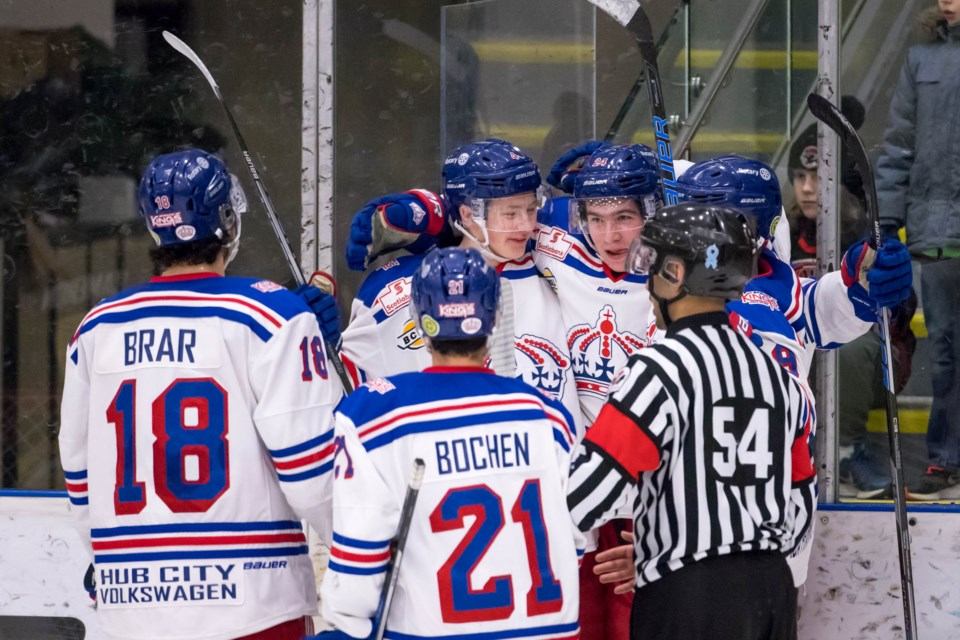 Prince George Spruce Kings celebrate a goal on the road against the Coquitlam Express (via Damon James Photography)