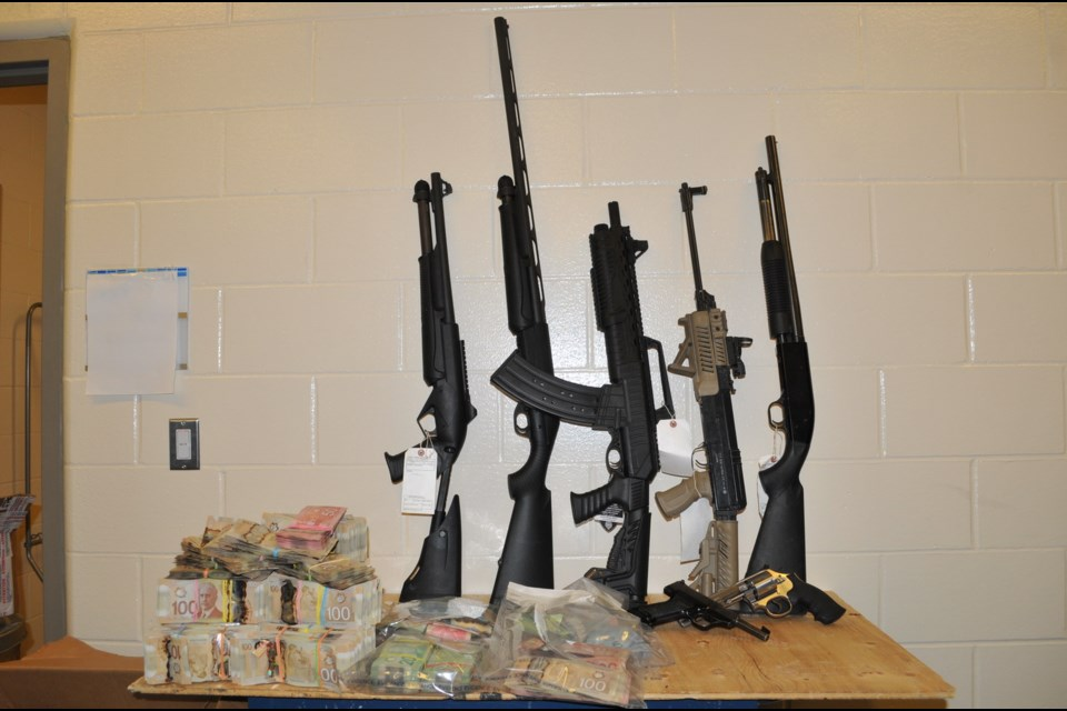 Guns and ammunition were taken from the residence. (via Prince George RCMP)