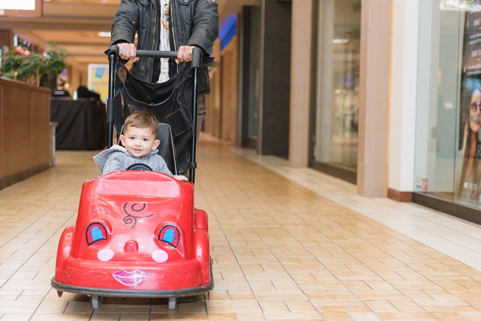 A parent pushing her child in a kid's cart at the Pine Centre Mall in Prince George (via Facebook/Pine Centre Mall)