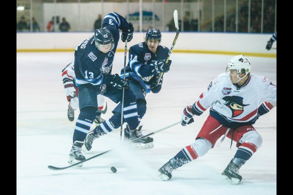 Canmore Eagles centre Alex Young clashes with the Brooks Bandits last season. RMO FILE PHOTO