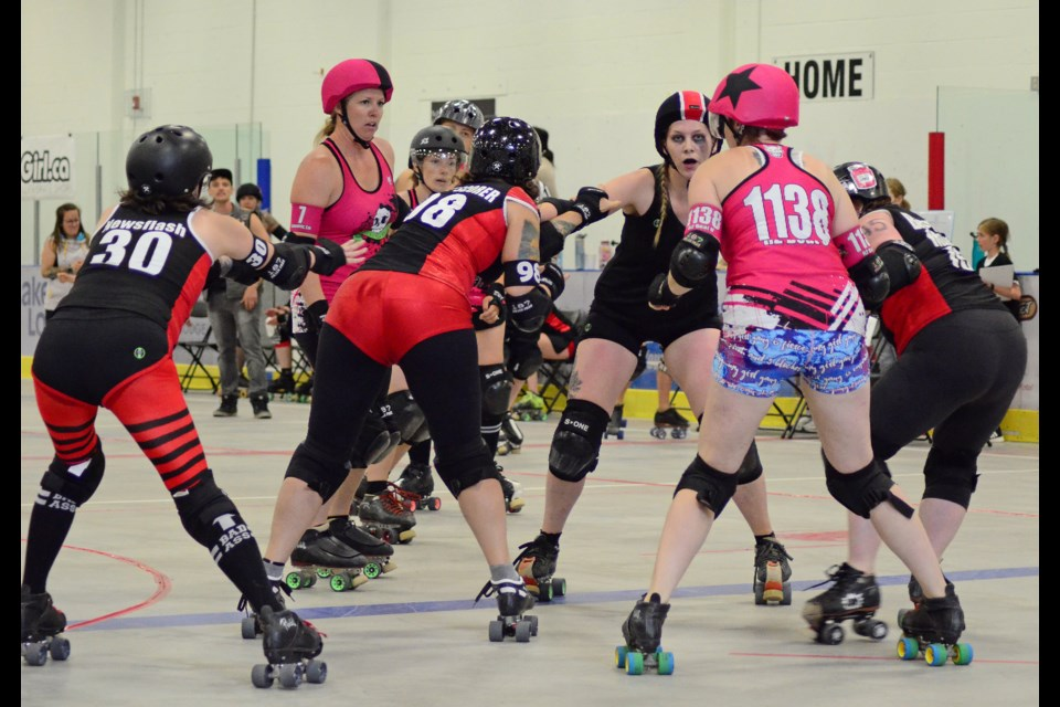 The Lady Macs (black and red) faced off against the Rocky View Rollers (pink) on Saturday, July 27, in the first competition Roller Derby bout the Bow Valley has seen since 2016. Jenna Dulewich/RMO PHOTOS