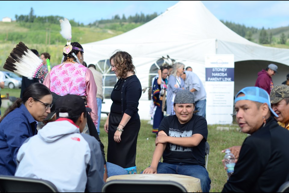 Nation members and guests get together to celebrate the opening of the Stoney Nakoda Parent Link Centre on Aug. 7. Jenna Dulewich RMO PHOTO