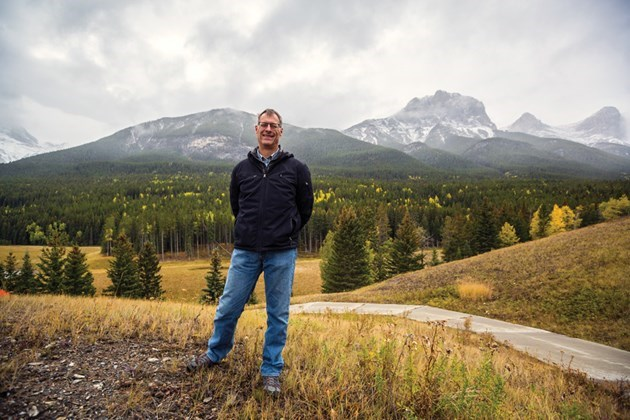 Three Sisters Mountain Village chairman David Taylor stands next to the proposed development site for a resort centre in Canmore in September. RMO File Photo