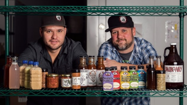 Bow Valley BBQ owner Jamie Ayles, left, along with operations manager Chris Dean show off some of the company's products on Thursday (Dec. 8).