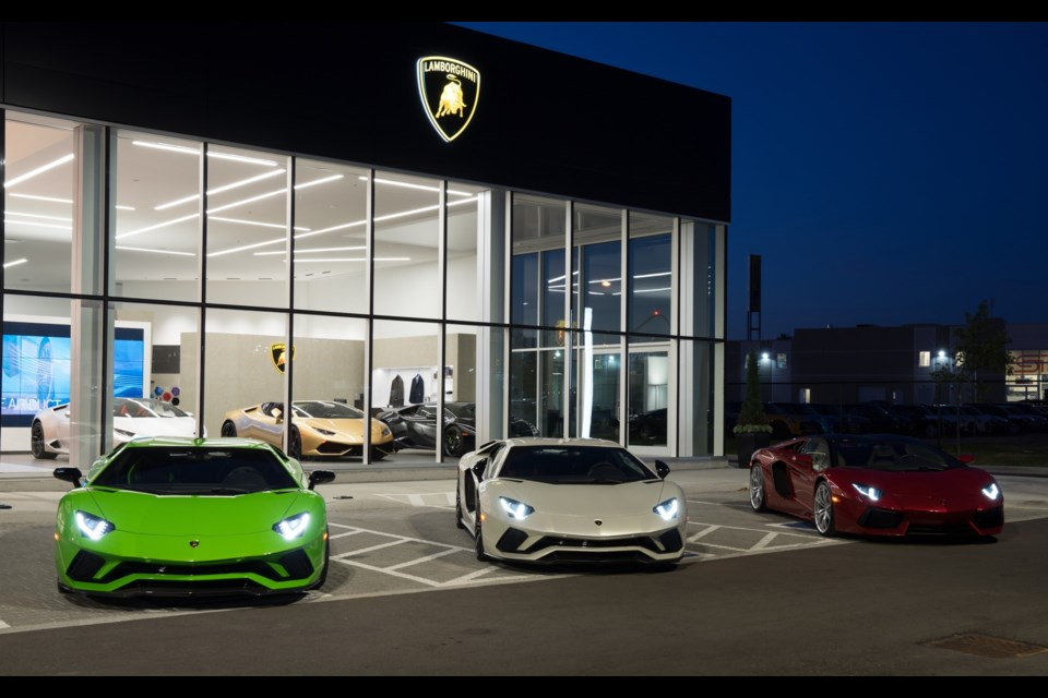 Lamborghini Uptown in Vaughan - Green, White and Red Aventadors parked outside to replicate the colors of the Italian flag. Credit Lamborghini