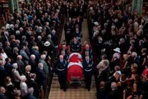 Mauril Belanger's funeral ends with gender neutral rendition of O Canada
