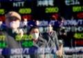 Asian shares mixed after Nasdaq hits record high