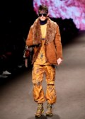 Impish, boyish looks permeate Milan's menswear runways