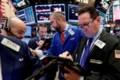 Stocks end mixed as investors seek safety; industrials slide