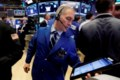 Stocks sink early on Washington worries before paring losses