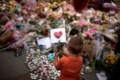 The Latest: Faith leaders lead vigil for bomb victims