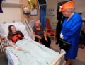 Queen Elizabeth visits young survivors of concert blast