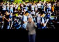 The Latest: Analyst says late doesn't mean out for Apple