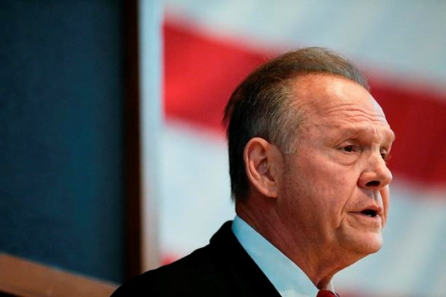Moore, Strange trade barbs in contentious debate