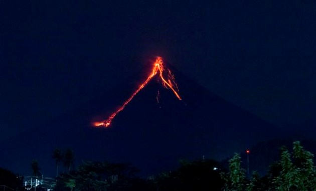 Philippines widens evacuation area as lava spreads around restive volcano