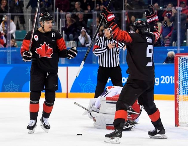 Gold in bobsled, women's hockey advance to final