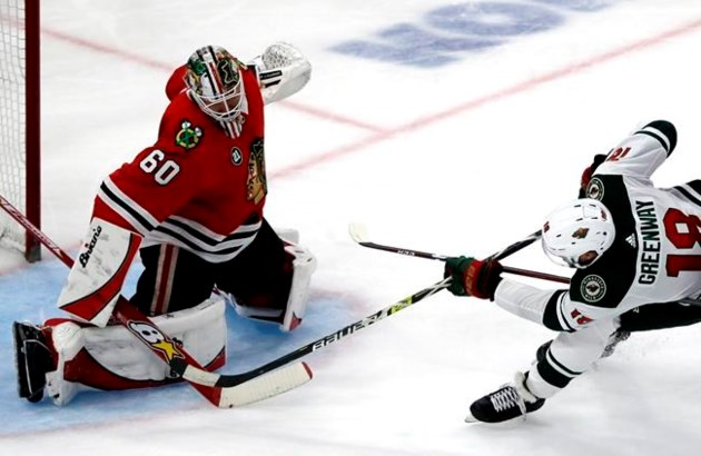 the latest c5ad4 a0f16 Kane gets hat trick to lift Blackhawks over Wild 5-2