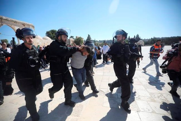 Image result for Muslims clash with Israeli police at Jerusalem holy site