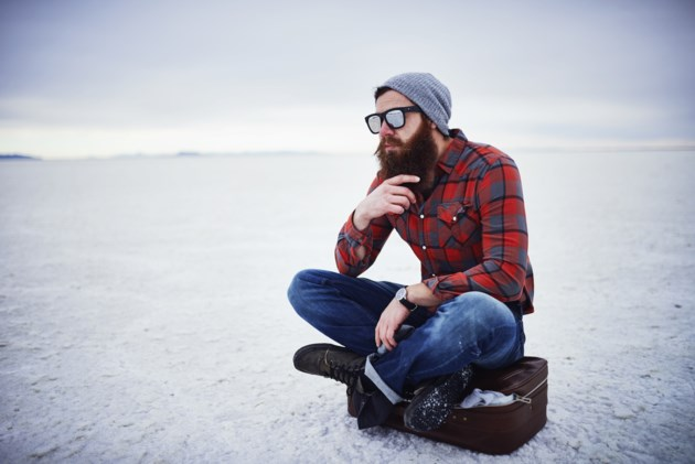 hipster in deep thought stock