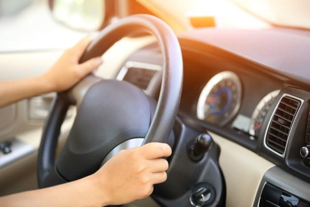 steering wheel woman stock