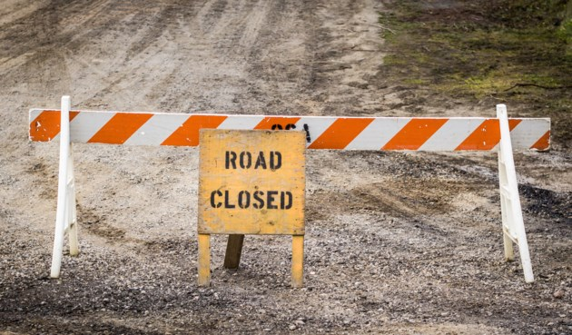 dirt road closed AdobeStock