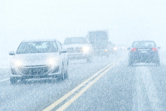 winter driving snowing AdobeStock_49094361