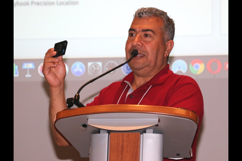 Sarmad Ibrahim, a member of IBM's National Innovation Team, was in Sudbury Tuesday to help local mining businesses understand the importance of incorporating new technology into their operations. Ibrahim held up an IBM Q, the company's newest quantum computer. The event was held at the Cambrian College Centre for Smart Mining.  (LEN GILLIS / SMSJ 2019)