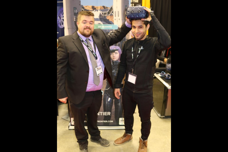 Next Frontier Corp. CEO Jason Michaud of Cochrane, left, was with technology officer Jawad El Houssine to demonstrate a virtual reality headset along with a virtual reality bodysuit. Both men were at the Big Event Mining Expo held in Timmins in June.