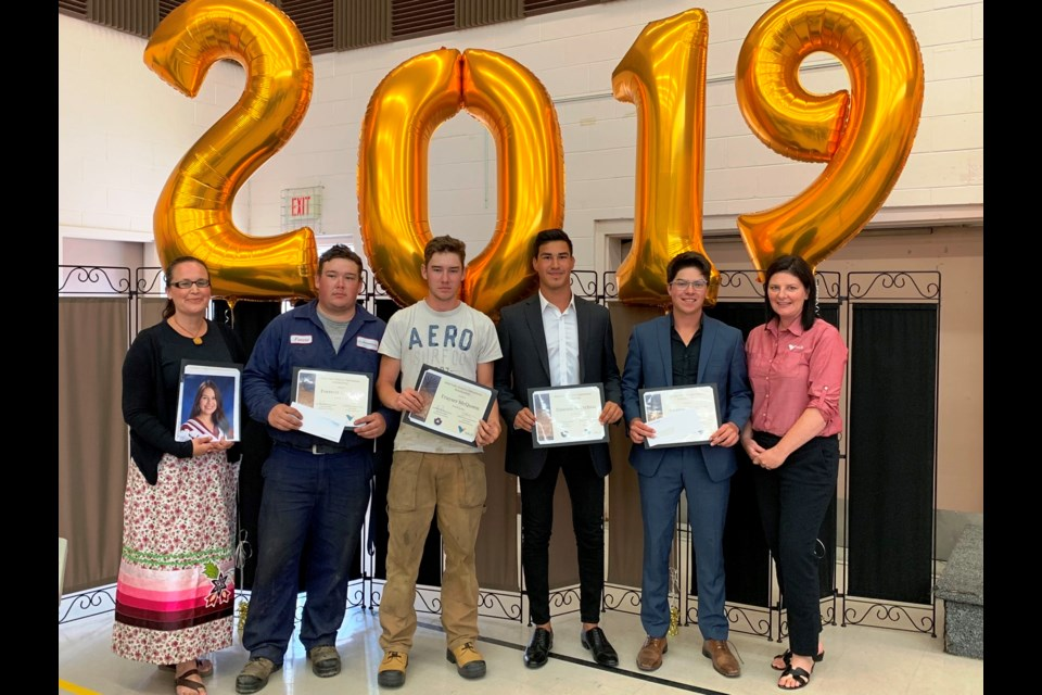 Vale Ontario Operations Scholarship Award winners. From left to right: Jennifer Petahtegoose (in place of her daughter Hannah Morningstar), Forrestt McQueen, Frayser McQueen, Dawson Nootchtai, Conrad Naponse, Danica Pagnutti Senior Advisor, Vale. (PHOTO SUPPLIED)