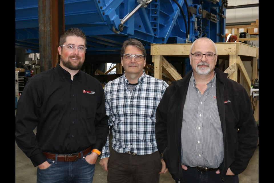 Some key members of the Variant Mining Technologies team in Sudbury involved in the creation of the world's largest mining chute included, at left, Derek Meloche, the manager of business development and sales; Stephen Scott, manager of projects and Paul Chamberland, Variant's general manager.
