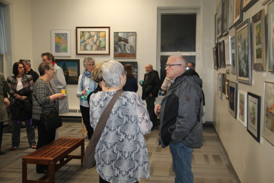 Artists, members of the public, mingle at the opening of the Algoma Art Society's 70th anniversary exhibit at the Sault Ste. Marie Museum, March 1, 2018. Darren Taylor/SooToday