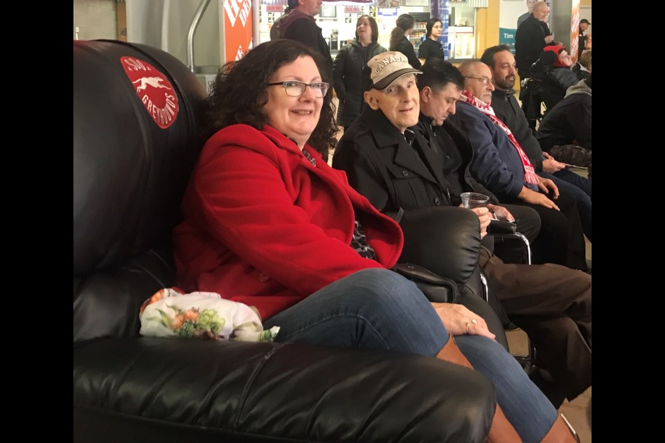 Ninety-four-year-old World War II veteran Robert Bonell enjoys a Soo Greyhounds game from the Best Seats in the House.