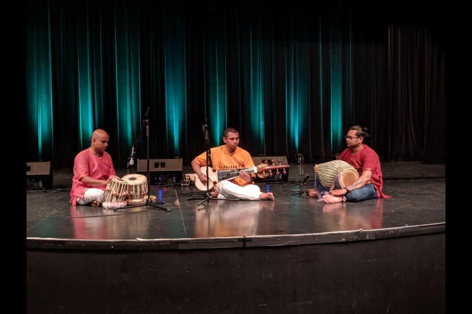Ananda playing the tabla drum, Dwarkanath playing the sarod and Gopal playing the mrdunga drum