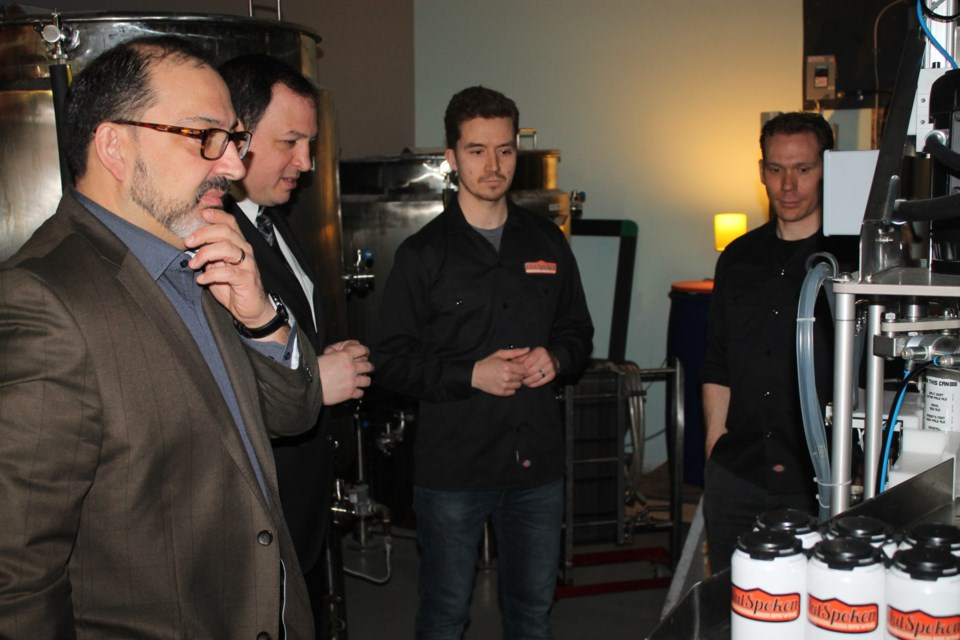 Glenn Thibeault, Minister of Energy, Christian Provenzano, Sault mayor, along with OutSpoken Brewing co-owners Graham Atkinson and Vaughn Alexander at a funding announcement for the Sault microbrewery, Apr. 21, 2017.  Darren Taylor/SooToday