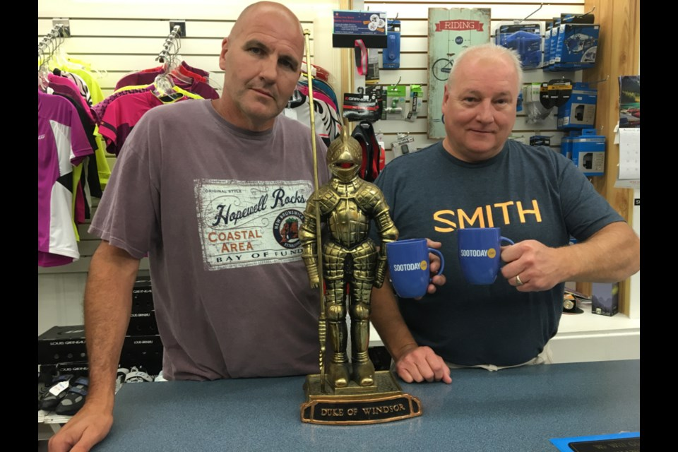 Mark Pettalia, Duke of Windsor Sport Shop sales and service technician, and Chris Theriault, Duke of Windsor Sport Shop owner/operator, with a pair of SooToday mugs.  Darren Taylor/SooToday