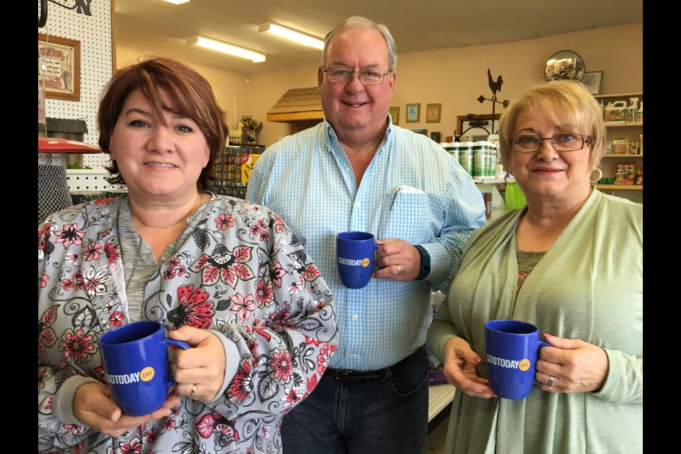 Jim Shaw, Shaw Milling owner/operator, with staff members Jennifer Berry and Diane Cristillo with SooToday mugs, Nov. 22, 2017. Darren Taylor/SooToday