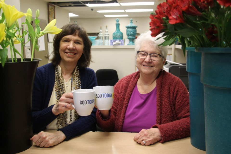 Gudrun Schatzler and Shirley Richards, co-owners and operators of Mann Florist, with their complimentary SooToday mugs, Jan. 10, 2018. Darren Taylor/SooToday