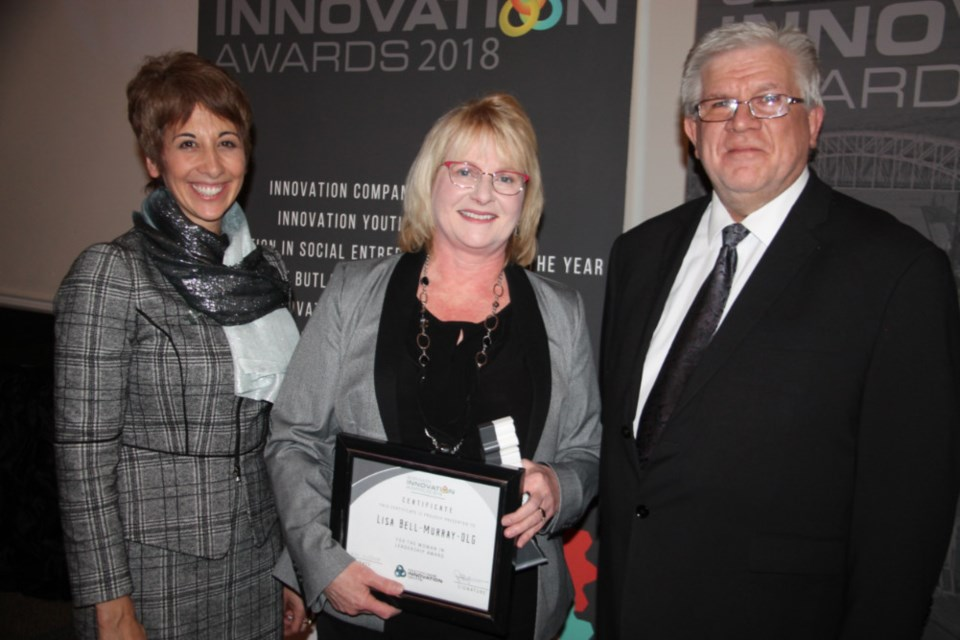 Asima Vezina, Algoma University president and vice-chancellor, Lisa Bell-Murray, OLG chief financial officer and SSMIC SSMARt Innovation Award winner (Woman in Leadership Award) and Peter Bruijns, SSMIC executive director, Nov. 21, 2018. Darren Taylor/SooToday