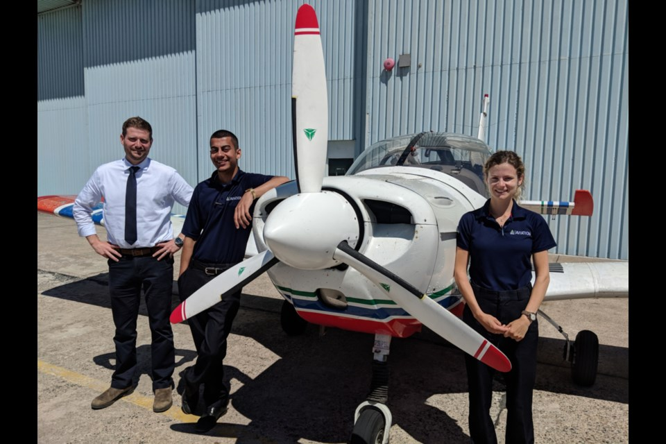 Jim Cairns, Sault College aviation technology-flight program instructor, with students Moiz Khatra and Marla Keyes, June 21, 2019. Darren Taylor/SooToday