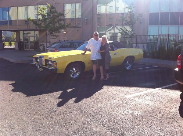 Jeff Ansley and wife Brenda with his parents' 1973 Mercury Cougar convertible.  Photo supplied by Jeff Ansley.