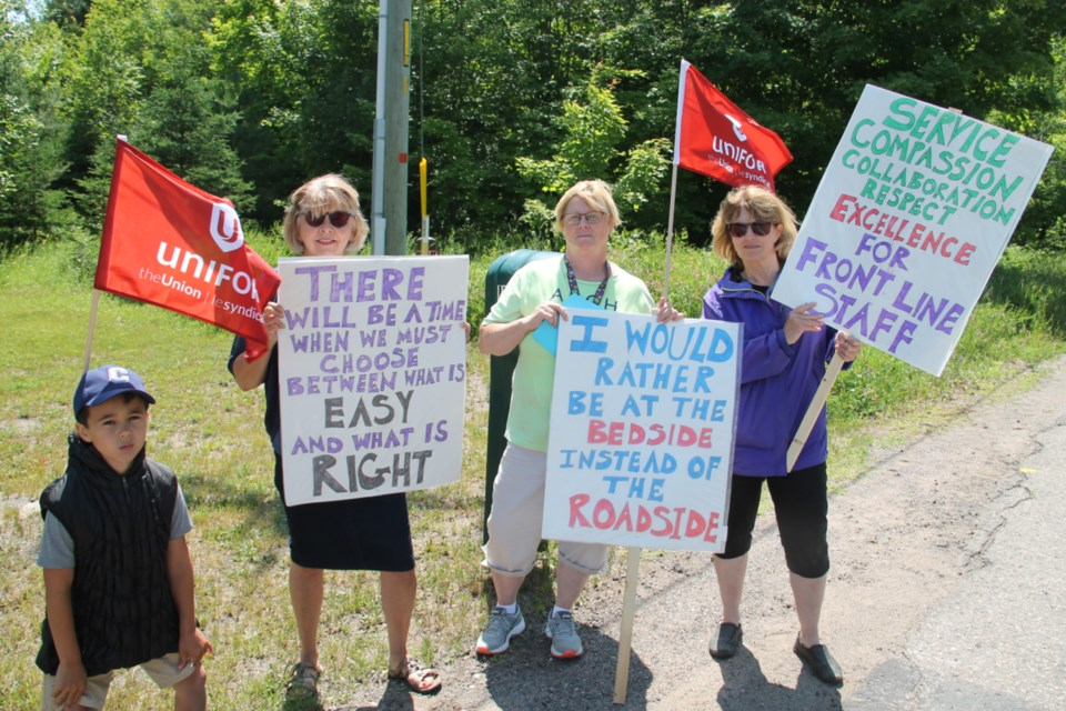 A group of ARCH employees, represented by Unifor Local 1359, have set up information lines outside the Sault's end of life care facility on Fourth Line, July 11, 2019. Darren Taylor/SooToday