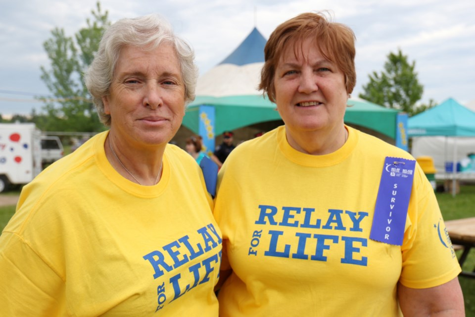 Sisters Nancy Turbin, left, and Donna Rickard - both survivors of cancer - wanted to walk the survivors lap at Relay For Life to honour family members who have been impacted by cancer. James Hopkin/SooToday
