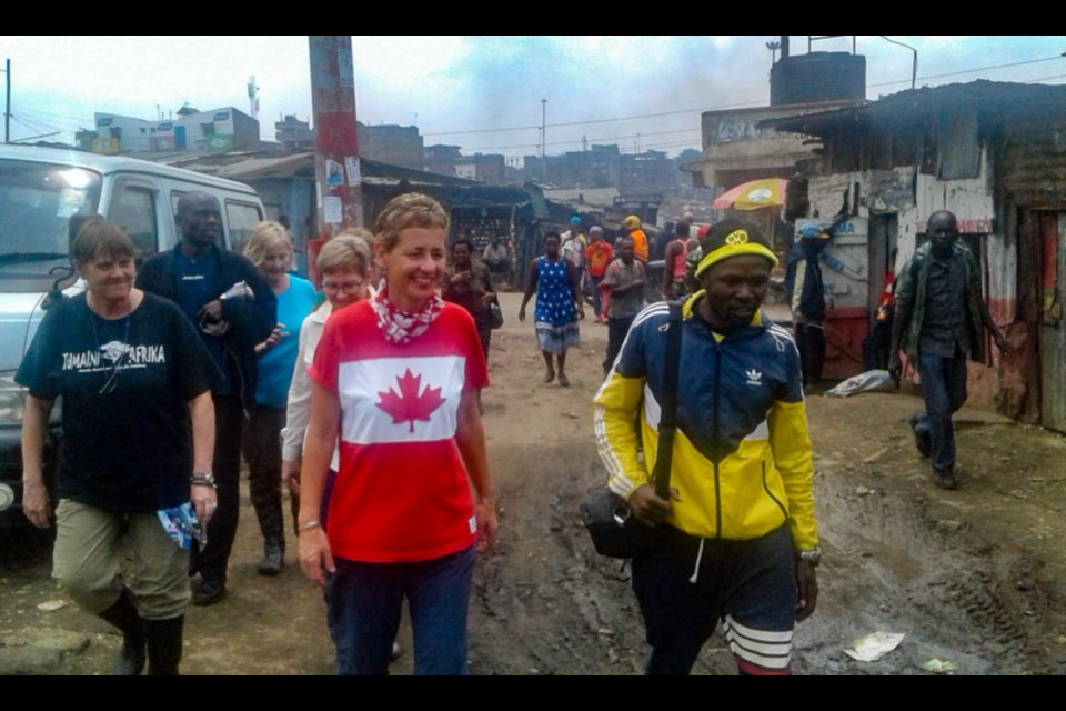 Jeannine Jefferson and members of Tumaini Afrika walk through the Mathare Slums in Nairobi. Photo supplied