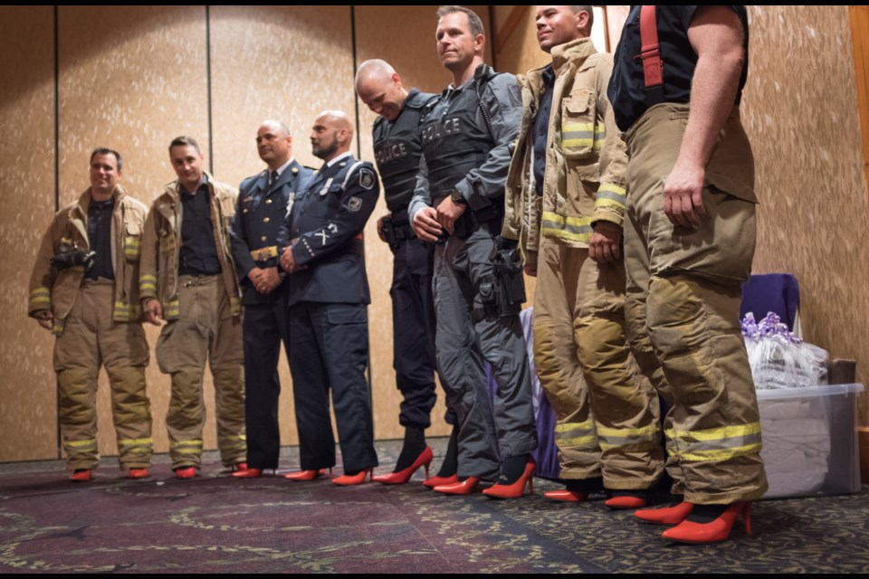 Firefighters and and police officers wore red high heel shoes at the official launch of Women in Crisis (Algoma)'s Walk a Mile in her Shoes Campaign on Thursday night. Jeff Klassen/SooToday