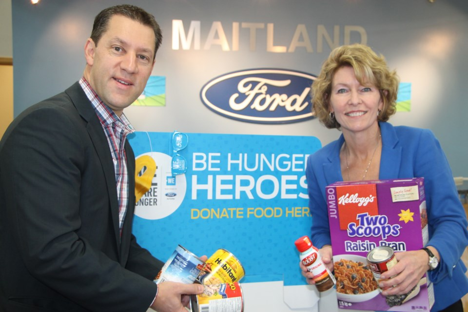 Sault MPP David Orazietti and Maitland Ford Lincoln's Judith Kovala are doing their part to fight local hunger by donating to the WE Scare Hunger program, October 24, 2016. Darren Taylor/SooToday