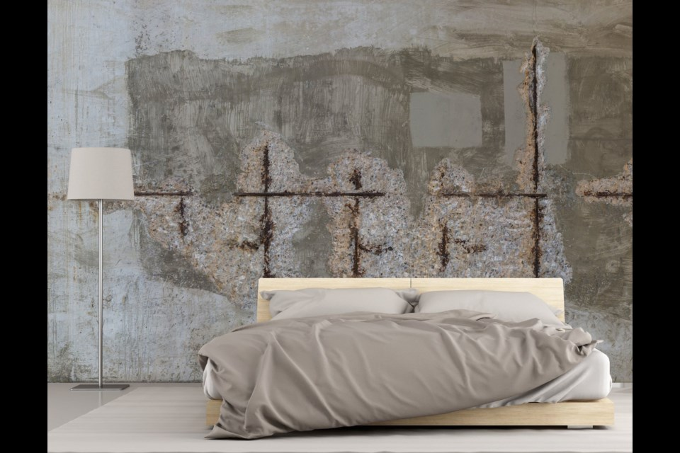 Transform a wall with a broad textural image of aged concrete from Muralunique.