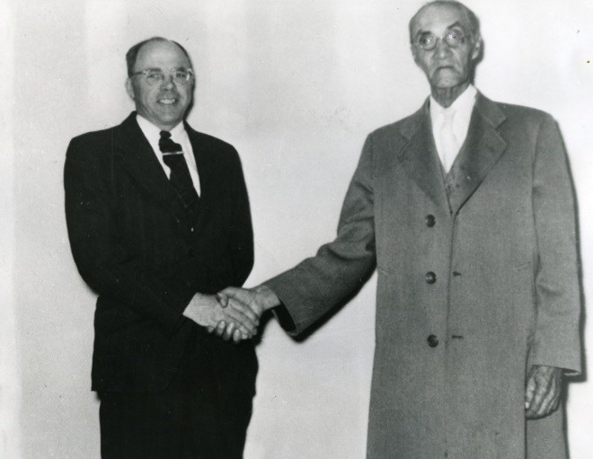 Incoming clerk, Robert Beaton is pictured with retiring clerk Richard M. Moore in Korah Township on June 2, 1954. Sault Ste. Marie Public Library archive photo